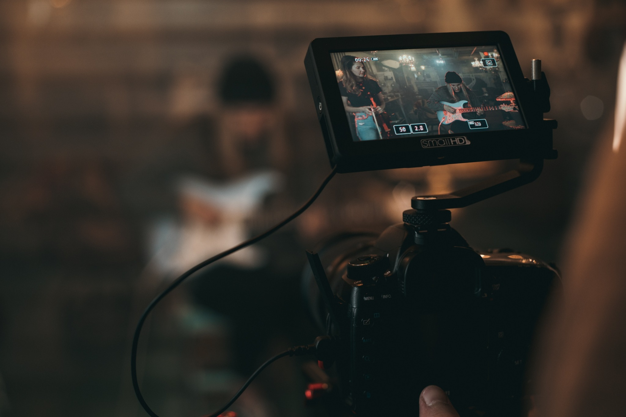 Shooting a video of someone playing guitar